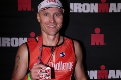 Chad with Ironman medal